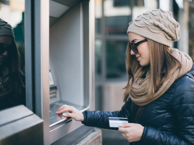 student using card at atm