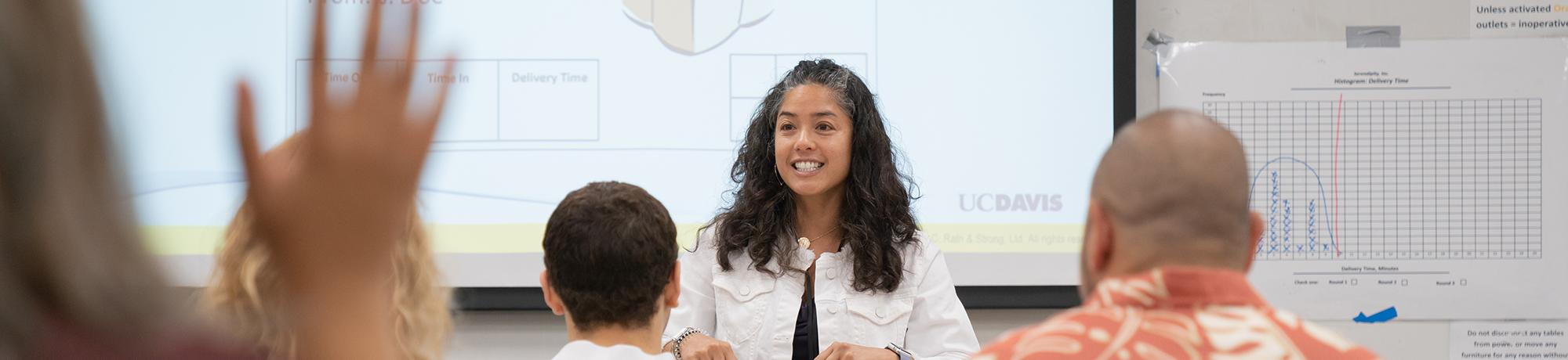 woman smiling and answering questions during a workshop